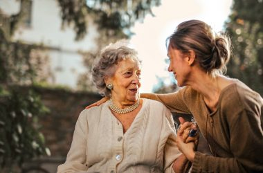 a volunteer with old woman