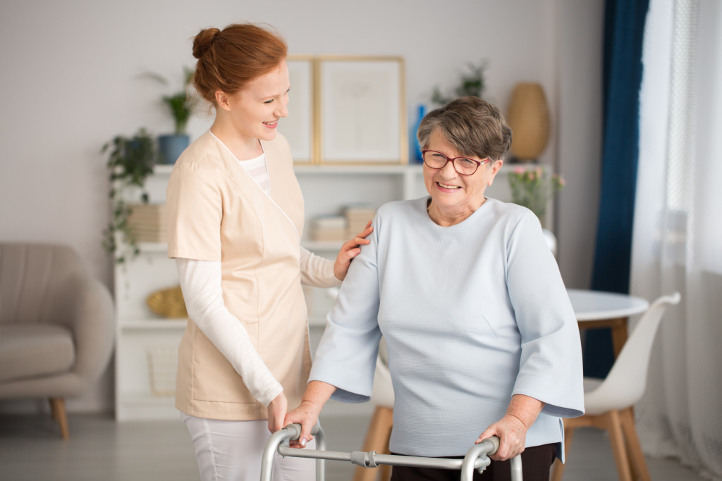 old woman with a caregiver